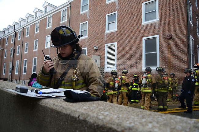 Maj. Maria Roberts directs the teachers on the second story of Boyd Hall about the next exercise during  firefighter training hosted by the Lexington Fire Department Officers Training Academy in Lexington, Ky., on Wednesday, January 15, 2014. Photo by Eleanor Hasken   Staff