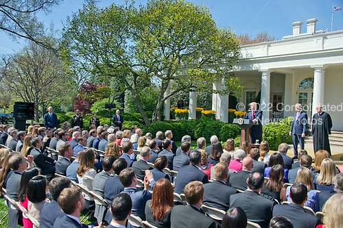 United States President Donald J. Trump, left, makes remarks from a teleprompter (far left) during the ceremony where Associate Justice of the US Supreme Court Neil Gorsuch, center, will be taking the Oath of Office from Associate Justice Anthony Kennedy, right, in the Rose Garden of the White House in Washington, DC on Monday, April 10, 2017.<br /> Credit: Ron Sachs / CNP<br /> (RESTRICTION: NO New York or New Jersey Newspapers or newspapers within a 75 mile radius of New York City)