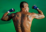 "This is fighter John ""Boom Boom"" Andre on September 18, 2010. Dhafir Harris, ""Dada 5000"", puts on backyard fights at his mother house, which go viral on youtube and have been the subject of documentaries. Sometimes the men fight until they are unconscious. There' s no gloves and occasionally, there's a cage. The community has taken to the events, because they are able to set up businesses selling food and washing cars."
