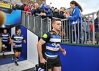 George Ford and the rest of the Bath Rugby team make their way onto the pitch. Aviva Premiership match, between Bath Rugby and Northampton Saints on December 5, 2015 at the Recreation Ground in Bath, England. Photo by: Patrick Khachfe / Onside Images
