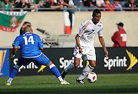 Cuba's Marcel Hernadez dribbles away from El Salvador's Dennis Alas.  El Salvador defeated Cuba 6-1 at the 2011 CONCACAF Gold Cup at Soldier Field in Chicago, IL on June 12, 2011.