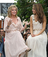 "Kathy Hilton, Maria Menounos.Gabriel Mann And Kathy And Paris Hilton Fashion Show On ""Extra"" Held at The Grove, West Hollywood, California, USA..May 2nd, 2012.full length beige maxi dress hands sitting profile pink.CAP/ADM/KB.©Kevan Brooks/AdMedia/Capital Pictures."