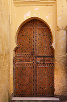 Detail of doorway in the Medina, Fez, Morocco, pictured on February 25, 2009 in the morning. Fez, Morocco's second largest city, and one of the four imperial cities, was founded in 789 by Idris I on the banks of the River Fez. The oldest university in the world is here and the city is still the Moroccan cultural and spiritual centre. Fez has three sectors: the oldest part, the walled city of Fes-el-Bali, houses Morocco's largest medina and is a UNESCO World Heritage Site;  Fes-el-Jedid was founded in 1244 as a new capital by the Merenid dynasty, and contains the Mellah, or Jewish quarter; Ville Nouvelle was built by the French who took over most of Morocco in 1912 and transferred the capital to Rabat. Picture by Manuel Cohen.