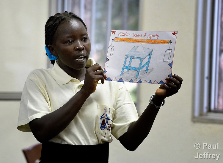 A student shares  drawing she made during an assembly in the Catholic Health Training Institute in Wau, South Sudan. The Institute trains nurses and midwives in the newly independent country, and is coordinated by Solidarity with South Sudan, an international consortium of more than 200 religious congregations that trains teachers, health workers and pastoral personnel in several locations throughout South Sudan.