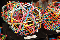 New York, NY, USA - June 22, 2012: Colorful modular Origami polyhedrons designed and folded by Byriah Loper, from Kentucky (left)  on display at the OrigamiUSA 2012 convention exhibition held at Fashion Institute of Technology in New York City.