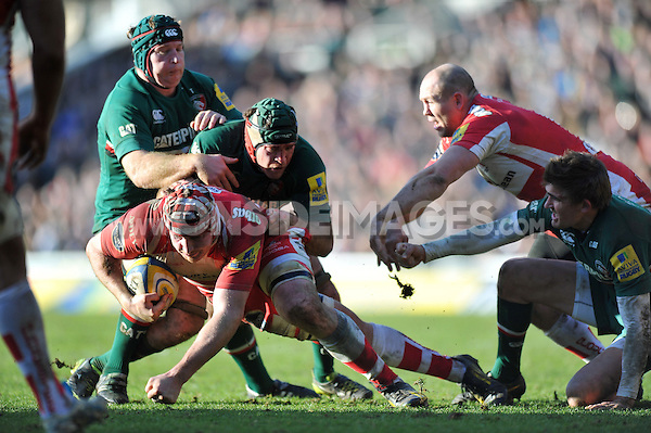 Ben Morgan is tackled to ground by Julian Salvi. Aviva Premiership match, between Leicester Tigers and Gloucester Rugby on February 16, 2014 at Welford Road in Leicester, England. Photo by: Patrick Khachfe / JMP