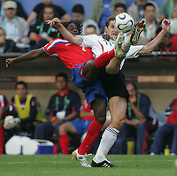 JUNE 9, 2006: Munich, Germany: German forward Miroslav Klose (11) tries to keep possession away from Costa Rican defender Jervis Drummond (2) during the World Cup Finals in Munich, Germany.  Germany defeated Costa Rica, 4-2.
