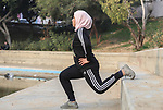Dania El Masry, 20-years old a Palestinian woman from Khan younis student of Physical Therapy, plays CrossFit sport at a garden in the southern Gaza strip, on Feb. 07, 2017. CrossFit workouts incorporate elements from high-intensity interval training, Olympic weightlifting, plyometrics, powerlifting, gymnastics, girevoy sport, calisthenics, strongman, and other exercises. Photo by Mofeed Abo Zaida