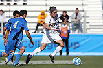 14 December 2014: Virginia's Patrick Foss (20) and UCLA's Grady Howe (4). The University of Virginia Cavaliers played the University of California Los Angeles Bruins at WakeMed Stadium in Cary, North Carolina in the 2014 NCAA Division I Men's College Cup championship match. Virginia won the championship by winning the penalty kick shootout 4-2 after the game ended in a 0-0 tie after overtime.