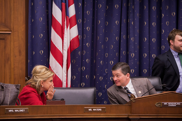 UNITED STATES - FEBRUARY 15:  House Financial Services Committee Chairman Jeb Hensarling, R-Texas, talks with Rep. Carolyn Maloney, D-N.Y., before a hearing in Rayburn Building to discuss an oversight plan for the 113th Congress. (Photo By Tom Williams/CQ Roll Call)