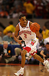 Juan Dixon (3) of Maryland pushes the ball upcourt during the NCAA Men's Division I Basketball Championships held at the Georgia Dome in Atlanta, GA. The Terapins of Maryland went on defeat the Indiana Hoosiers 64-52 for the championship title..Photo: Ryan McKee/NCAA Photos