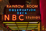 Neon Sign on 30 Rockefeller Center Entrance overhang, with NBC Sudios, Rainbow Room, and Observation deck bright lighted letters, seen from below, on January 9, 2012, in Manhattan, New York, City, NY, USA.