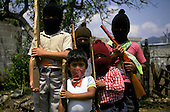 = Children playing zapatist guerrilla in San Cristobal  Chiapas  Mexico    /// enfants jouant à la guérilla Zapatiste à San Cristobal  Chiapas  Mexique  +