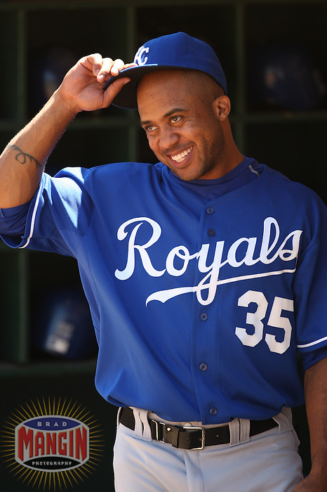 OAKLAND, CA - AUGUST 19:  Emil Brown of the Kansas City Royals prepares in the dugout before the game against the Oakland Athletics at McAfee Coliseum in Oakland, California on August 19, 2007.  The Athletics defeated the Royals 6-1.  Photo by Brad Mangin