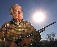 Gilbert Crutchfield holds a 12 gauge shotgun at his home in Tanner.  Sixty five years ago, Crutchfield was holding a shotgun on Pearl Harbor on that fateful morning when he encountered the Empire of the Rising Sun.  photo by Gary Cosby jr.  12/5/06