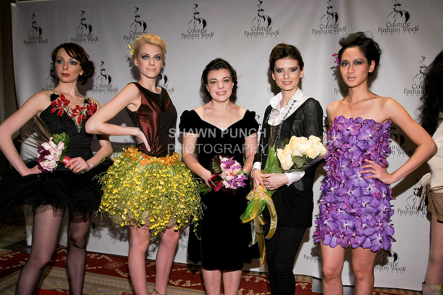 """(l-r) Era Chorna, Jaqueline Backer, Lena Yelagina, Olga Meshcheryakova, and Elizabeth ThuyTien pose on the red carpet after the Alaric Design Floral Concept Dress """"Arrangement Collection"""" fashion show, during Couture Fashion Week Fall 2011."""
