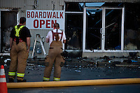 Firefighters are seen where a massive fire that engulfed dozens of businesses along a boardwalkin in Seaside Park September 13, 2013 by Kena Betancur / VIEWpress