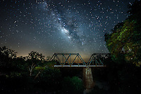 We  captures the milky way pictures as it came up from behind an old railroad bridge.  It is not easy to get a picture of the milk way when you live near a big city because of all the light pollution so we had to venture out a way just to capture this milky way photo. This photo is currently on display at Austin City Hall  for a year for Art in Public Places
