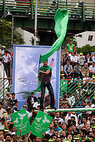 Supporters of former prime minister Mir-Hossein Mousavi at a rally at Heravi stadium before the 2009 presidential election.
