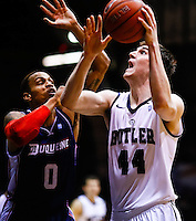 INDIANAPOLIS, IN - FEBRUARY 19: As Andre Marhold #0 of the Duquesne Dukes defends Andrew Smith #44 of the Butler Bulldogs shoots the ball at Hinkle Fieldhouse on February 19, 2013 in Indianapolis, Indiana. Butler defeated Duquesne 68-49. (Photo by Michael Hickey/Getty Images) *** Local Caption *** Andre Marhold; Andrew Smith