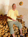 Louis Pope juggling coconuts in the storage room of Coast Coconut Farms, Kenya.  Coast Coconut Farms was started in 2005 by The Pope Foundation as an economic development project with a mission to provide sustainable employment, management and ownership opportunities for the rural people of Kenya.