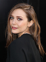 """HOLLYWOOD, LOS ANGELES, CA, USA - MAY 08: Elizabeth Olsen at the Los Angeles Premiere Of Warner Bros. Pictures And Legendary Pictures' """"Godzilla"""" held at Dolby Theatre on May 8, 2014 in Hollywood, Los Angeles, California, United States. (Photo by Xavier Collin/Celebrity Monitor)"""