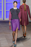 Ruby Aldridge walks the runway in a green/purple/orange cotton crop-sleeved rugby shirt, and purple leather wrap skirt, by Tommy Hilfiger for the Tommy Hilfiger Spring 2012 Pop Prep Collection, during Mercedes-Benz Fashion Week Spring 2012.