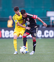 Rafael Teixeira (9) of D.C. United fights for the ball with Agustin Viana (24) of the Columbus Crew during the game at RFK Stadium in Washington, DC.  Columbus Crew defeated D.C. United, 2-1.