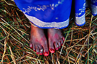 Beautiful feet of a traditional India woman. She just took a bath in the Sangam on Mauni Amavasya during the Kumbh Mela in Allahabad.