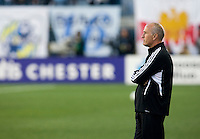 Houston Dynamo head coach Dominic Kinnear watches his team before the game at PPL Park in Chester, PA.  Houston defeated Philadelphia, 2-1, to take home the one goal advantage in the home and home series..