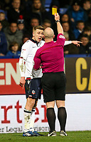 Bolton Wanderers' Josh Vela is shown a yellow card by referee Simon Hooper<br /> <br /> Photographer Alex Dodd/CameraSport<br /> <br /> The EFL Sky Bet League One - Bolton Wanderers v Bury - Tuesday 18th April 2017 - Macron Stadium - Bolton<br /> <br /> World Copyright &copy; 2017 CameraSport. All rights reserved. 43 Linden Ave. Countesthorpe. Leicester. England. LE8 5PG - Tel: +44 (0) 116 277 4147 - admin@camerasport.com - www.camerasport.com