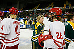 ST CHARLES, MO - MARCH 19:  Taylor Turnquist (17) of the Clarkson Golden Knights participates in the traditional post game handshake during the Division I Women's Ice Hockey Championship held at The Family Arena on March 19, 2017 in St Charles, Missouri. Clarkson defeated Wisconsin 3-0 to win the national championship. (Photo by Mark Buckner/NCAA Photos via Getty Images)