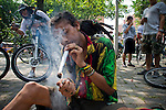 "Colombian people take part during the First ""World Bicicleteada Cannavica""  as they smoke while working out to promote the legalization of medical Marijuana in Medellin, Colombia, on October 6, 2012. Photo by Fredy Amariles Garcia /VIEWpress."