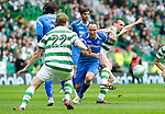Celtic v St Johnstone....01.04.12   SPL.Lee Croft battles with Scott Brown.Picture by Graeme Hart..Copyright Perthshire Picture Agency.Tel: 01738 623350  Mobile: 07990 594431