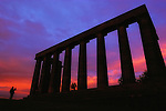 """National Monument, Edinburgh, Scotland..The so-called National Monument of Scotland sits atop Carlton Hill in Scotland's capital city Edinburgh. Designed by renowned architect Charles Cockerell, building commenced in 1822. But it was never completed. Local myth says that the intention was to build a full imitation of the Parthenon, but that a shortage of funds meant it was never completed. Locally it is nicknamed """"Edinburgh's Folly,"""" and """"Edinburgh's Disgrace."""""""