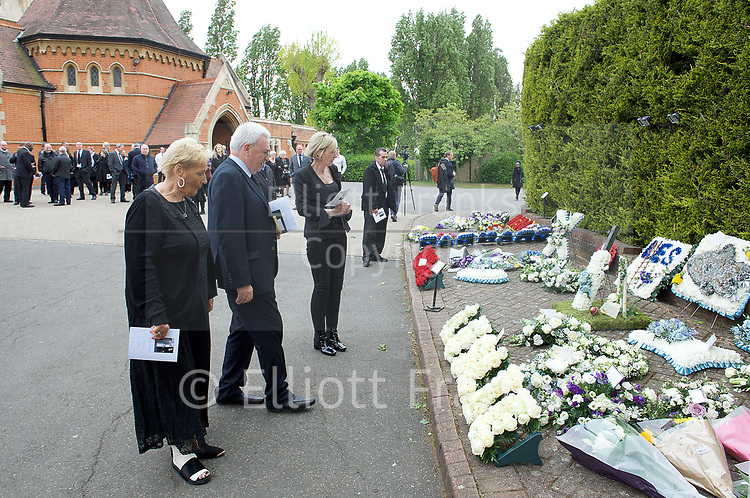 Leslie Rhodes funeral at North East Surrey Crematorium, Morden, Surrey, Great Britain 5th May 2017 <br /> <br /> his niece Amanda Rhodes looking at the floral tributes <br /> <br /> Leslie Rhodes was one of the victims of the Westminster terror attack on 22nd March 2017. Mr Rhodes was Winston Churchill's former window cleaner.<br /> <br /> Leslie Rhodes, from south London, suffered serious injuries when terrorist Khalid Masood mowed down pedestrians on Westminster Bridge. The 75-year-old was rushed to King&rsquo;s College Hospital but died there when his life support was withdrawn at about 8.25pm the following day. <br /> <br /> He had been attending an appointment at St Thomas&rsquo;s Hospital before Masood went on a rampage &ndash; killing four and injuring 50 before he was shot dead by police.<br /> <br /> Mr Rhodes, who friends revealed was the former window cleaner of Winston Churchill, suffered broken ribs and a punctured lung in the attack.<br /> <br /> <br /> Photograph by Elliott Franks <br /> Image licensed to Elliott Franks Photography Services