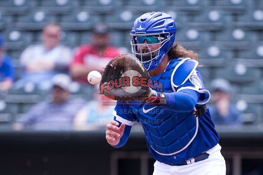 Jack Murphy (50) of the Oklahoma City Dodgers reaches for a throw to  home plate in a game against the Iowa Cubs at Chickasaw Bricktown Ballpark on April 9, 2016 in Oklahoma City, Oklahoma.  Oklahoma City defeated Iowa 12-1 (William Purnell/Four Seam Images)