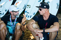 PIPELINE, Oahu, Hawaii (Tuesday, December 10, 2013) Mick Fanning (AUS) and coach Phil MacNamara (AUS) discuss tactics.   - The 2013 Billabong Pipe Masters in Memory of Andy Irons resumed today in six foot (2 metre) barrels and there was no shortage of drama in the ASP World Title race between Mick Fanning (AUS), 32, and Kelly Slater (USA), 41. There was also a shift in the Vans Triple Crown of Surfing Rankings as well as qualification developments for the 2014 WCT.<br /> <br /> The Billabong Pipe Masters represents the pinnacle of the 2013 ASP World Championship Tour, deciding the ASP World Title, Vans Triple Crown of Surfing, and final slots for 2014 ASP WCT qualification.<br /> <br /> Mick Fanning, two-time ASP World Champion and current No. 1, dominated his Round 3 clash with wildcard Kaimana Jaquias (HAW), 20, but unexpectedly erred in his three-man Round 4 heat against John John Florence (HAW), 21, and Nat Young (USA), 22. A last minute paddle battle with heat leader Florence in the closing seconds of the match took him from second to third and now pits him against one of the best Pipeline surfers in the world: C.J. Hobgood (USA), 34, in Round 5. Meanwhile, Slater skips Round 5 and heads straight to the Quarterfinals after his Round 4 win.<br /> <br /> Clearly disappointed with his misstep, Fanning couldn&rsquo;t leave the beach fast enough and wasn&rsquo;t prepared to talk about how this affects his approach to the final day of competition.<br /> <br /> Kelly Slater was electric in his bid for a historic 12th ASP World Title, earning the high heat-totals of both Round 3 and 4. Slater tore past Mitch Crews (AUS), 23, with a 17.66 out of 20 heat total for incredible Pipeline and Backdoor barrels and backed up the performance with a 17.50 out of 20 in Round 4.<br /> Photo: joliphotos.com