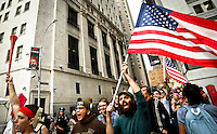 """New York, United States, September 21, 2011..Hundreds of protesters from the movement """"Occupy Wall Street""""   continue for 5th day, peaceful protests against the economic system around Wall Street in Zuccotti Park in New York. September 21, 2011. VIEWpress / Eduardo Munoz Alvarez..In New York, the Occupy Wall Street movement (which began on the 17th September this year) has spread throughout the country. What started as a peaceful protest to campaign against capitalism has now taken root in other cities such as Chicago and Boston. They claim to have been inspired by Egypt's Tahrir Square protests. Even Anonymous, the """"hacktivists"""", have emerged from their computer caves to take to the streets. Local Media Reported."""