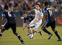 LA Galaxy forward Alan Gordon (21) moves with the ball between San Jose Earthquake players Ike Opara (6), Brandon McDonald (14) and Sam Cronin (4). The LA Galaxy and the San Jose Earthquakes played to a 2-2 draw at Home Depot Center stadium in Carson, California on Thursday July 22, 2010.