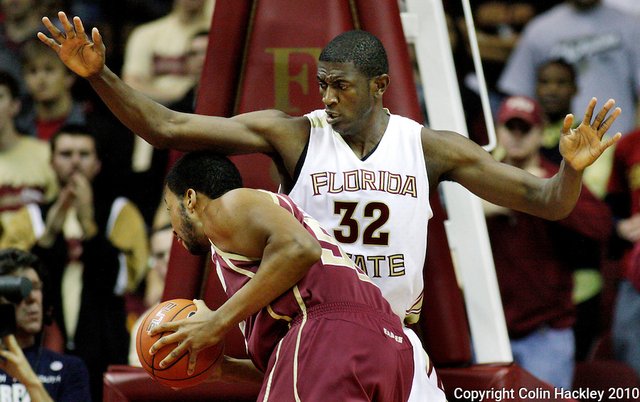 TALLAHASSEE, FL 2/14/10-FSU-BC BB10 CH05-Florida State's Solomon Alabi gets between Boston College's Josh Southern and the basket during first half action Sunday at the Donald L. Tucker Center in Tallahassee. The Seminoles beat the Eagles 62-47...COLIN HACKLEY PHOTO