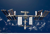 In Earth Orbit - March 25, 2009 -- Backdropped by a blue and white Earth, the International Space Station is seen from Space Shuttle Discovery as the two spacecraft begin their relative separation. Earlier the STS-119 and Expedition 18 crews concluded 9 days, 20 hours and 10 minutes of cooperative work onboard the shuttle and station. Undocking of the two spacecraft occurred at 2:53 p.m. (CDT) on March 25, 2009..Credit: NASA via CNP