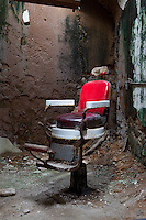 barber shop chair in an abandoned prison
