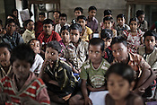 Children seen in a classroom in the local school for Chowduli children in Chaymalpur village of North 24 Parganas in West Bengal, India. Photo: Sanjit Das/Panos for The Wall Street Journal. Slug: ICASTE
