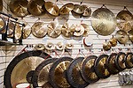 Percussion musical instruments, cymbals and gongs on display at a store in Shanghai, China