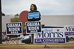 Dinorah Sapp holds a sign in support of President Obama outside the polls at the Oxford Mall in Oxford, Miss. on Tuesday, November 6, 2012.