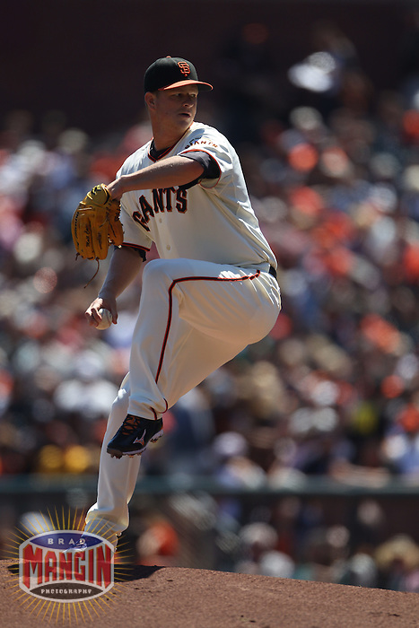 SAN FRANCISCO - AUGUST 28:  Matt Cain #18 of the San Francisco Giants pitches against the Houston Astros during the game at AT&T Park on August 28, 2011 in San Francisco, California. Photo by Brad Mangin
