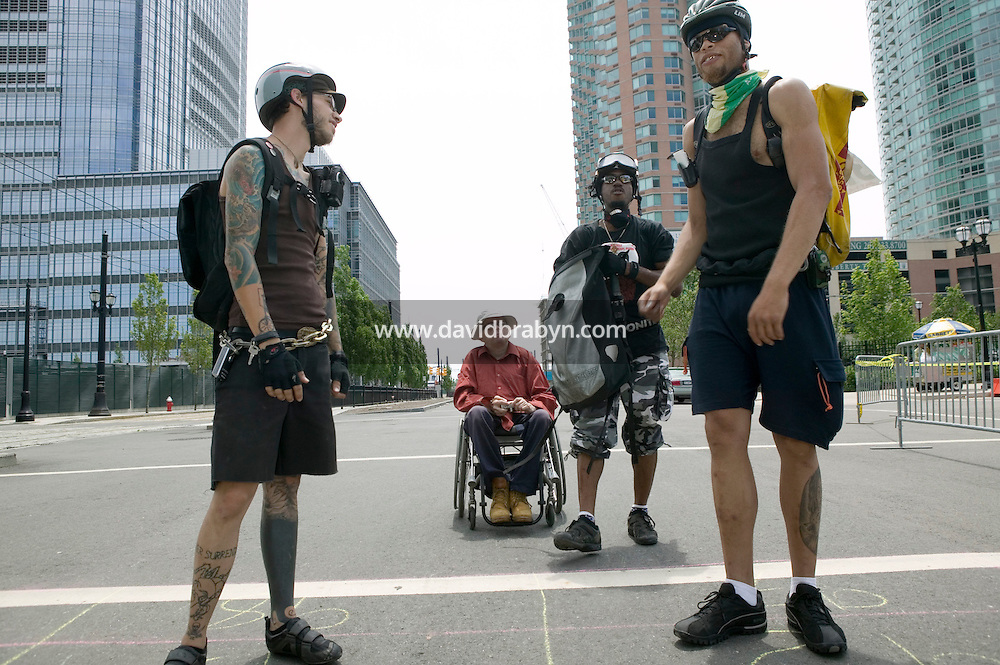 2 July 2005 - Jersey City, NJ, USA - Hans Witche (C, in wheelchair) observes riders preparing to compete in a qualifying race for the 13th annual cycle messenger world championships, Jersey City, USA, July 2nd 2005. More than 700 riders from all over the world took part in the 4-day competition which carries event based on the daily work of a city bike messenger.