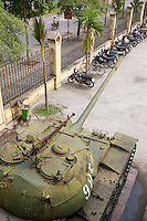 Vietnam. Hanoi. Military history museum. A military tank from the north vietnamese troops which won the war  against the USA. Moped and bicyles parked near the fence. 04.04.09 © 2009 Didier Ruef