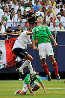 Jonny Magallon (2) of Mexico (MEX) and Davy Arnaud (22) of the United States (USA) go for a header. Mexico (MEX) defeated the United States (USA) 5-0 during the finals of the CONCACAF Gold Cup at Giants Stadium in East Rutherford, NJ, on July 26, 2009.